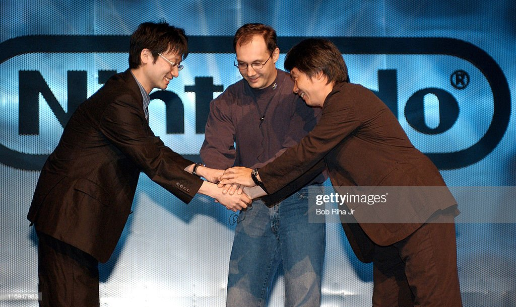 Legendary Nintendo video game designer Shigeru Miyamoto (right) welcomes Hideo Kojima from Konomi (left), creator of 'Metal Gear Solid' and Denis Dyack (Silicon Knights) to the stage at the Nintendo Press Conference Tuesday, May 13, 2003. The game designers joined forces to create an exclusive version of the popular action-espionage video game 'Metal Gear Solid:The Twin Snakes' which is scheduled for release late in 2003.