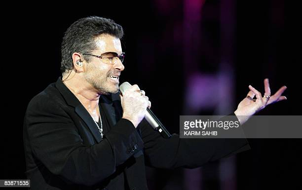 Legendary pop singer George Michael performs in concert at the Zayed Sports City stadium in Abu Dhabi on December 1 2008 Grammy award winning soul...