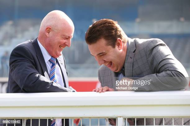 Legendary race caller Greg Miles who will call his final race meeting at Caulfield on Saturday and fellow race caller Matthew Hill share a laugh...