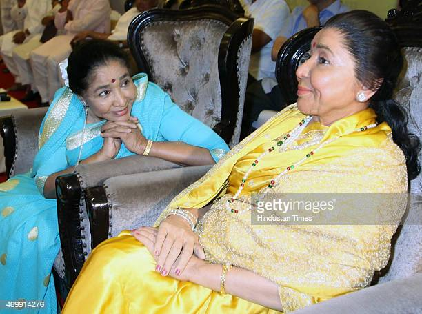 Legendary singer Asha Bhosle looking at her wax statue during the unveiling of her and NCP Chief Sharad Pawars wax statue at the MCA lounge of the...