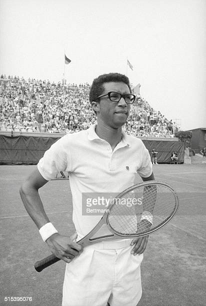 Legendary Tennis Professional Arthur Ashe Holding Racquet
