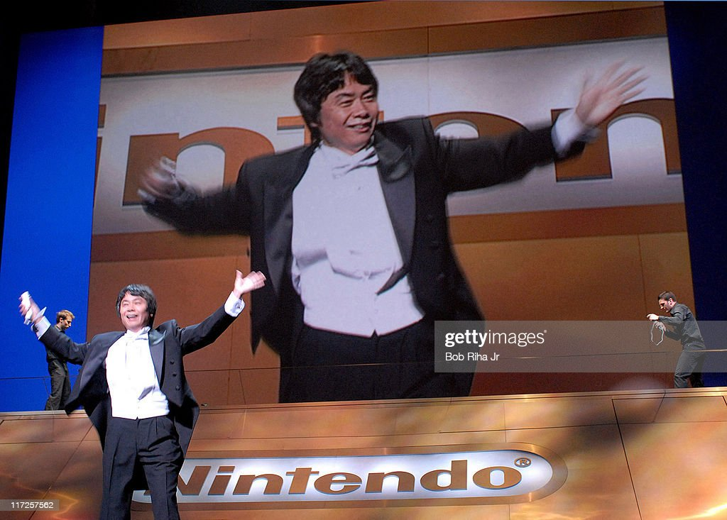 Legendary video game designer Shigeru Miyamoto uses a new wireless 'Wii Remote' to control the tempo of a video game orchestra during the Nintendo Media Briefing on Tuesday, May 9, 2006