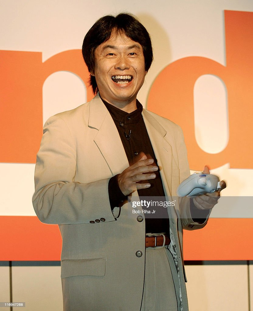 Legendary video game designer <a gi-track='captionPersonalityLinkClicked' href=/galleries/search?phrase=Shigeru+Miyamoto&family=editorial&specificpeople=2608501 ng-click='$event.stopPropagation()'>Shigeru Miyamoto</a> uses WaveBird, the new wireless Nintendo GameCube controller during a press conference, Tuesday, May 21, 2002 in Los Angeles, Calif.. Miyamoto also unvieled several new titles for the Nintendo GameCube unit and plans to have available over 150 games by the end of 2002.
