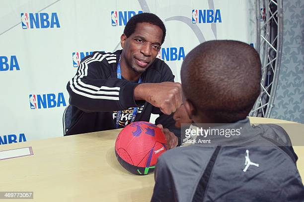Legends AC Green signs an autograph for a fan during the 2014 NBA AllStar Jam Session at the Ernest N Morial Convention Center on February 15 2014 in...
