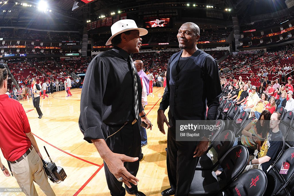 Legends and former Players of the Houston Rockets Robert Reid and <a gi-track='captionPersonalityLinkClicked' href=/galleries/search?phrase=Hakeem+Olajuwon&family=editorial&specificpeople=202637 ng-click='$event.stopPropagation()'>Hakeem Olajuwon</a> talk before the game between the Houston Rockets and the Detroit Pistons on March 1, 2014 at the Toyota Center in Houston, Texas.