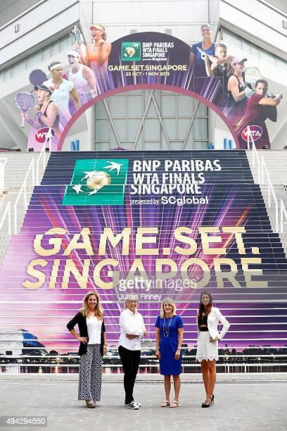 Legends Arantxa SanchezVicarioi Martina Navratilova Tracy Austin and Marion Bartoli pose for a photo during the BNP Paribas WTA Finals at Singapore...