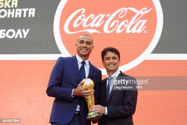 Legends Bebeto and David Trezeguet pose with the trophy during official kickoff event FIFA World Cup Trophy Tour at Luzhniki stadium on September 9...