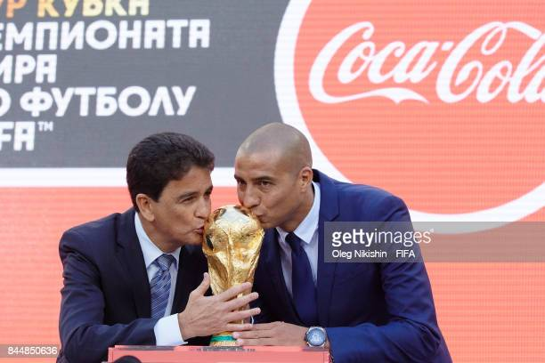 Legends Bebeto and David Trezeguet stay with the trophy during official kickoff event FIFA World Cup Trophy Tour at Luzhniki stadium on September 9...