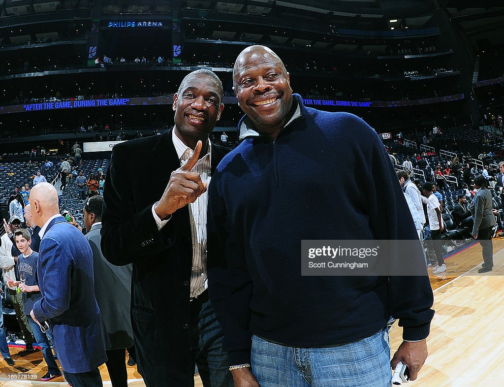 NBA Legends <a gi-track='captionPersonalityLinkClicked' href=/galleries/search?phrase=Dikembe+Mutombo&family=editorial&specificpeople=201659 ng-click='$event.stopPropagation()'>Dikembe Mutombo</a> and <a gi-track='captionPersonalityLinkClicked' href=/galleries/search?phrase=Patrick+Ewing&family=editorial&specificpeople=202881 ng-click='$event.stopPropagation()'>Patrick Ewing</a> watch the Philadelphia 76ers against the Atlanta Hawks on April 5, 2013 at Philips Arena in Atlanta, Georgia.