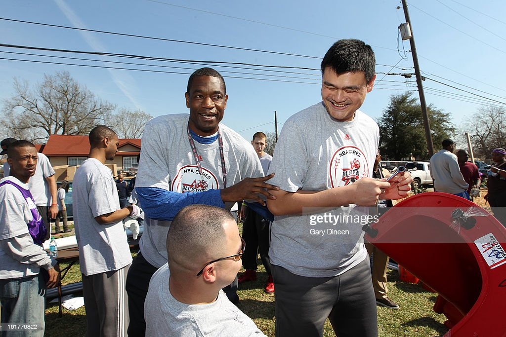 NBA Legends Dikembe Mutombo and Yao Ming help put together a playset at the 2013 NBA Cares Day of Service at the Playground Build with KaBOOM! on February 15, 2013 in Houston, Texas.