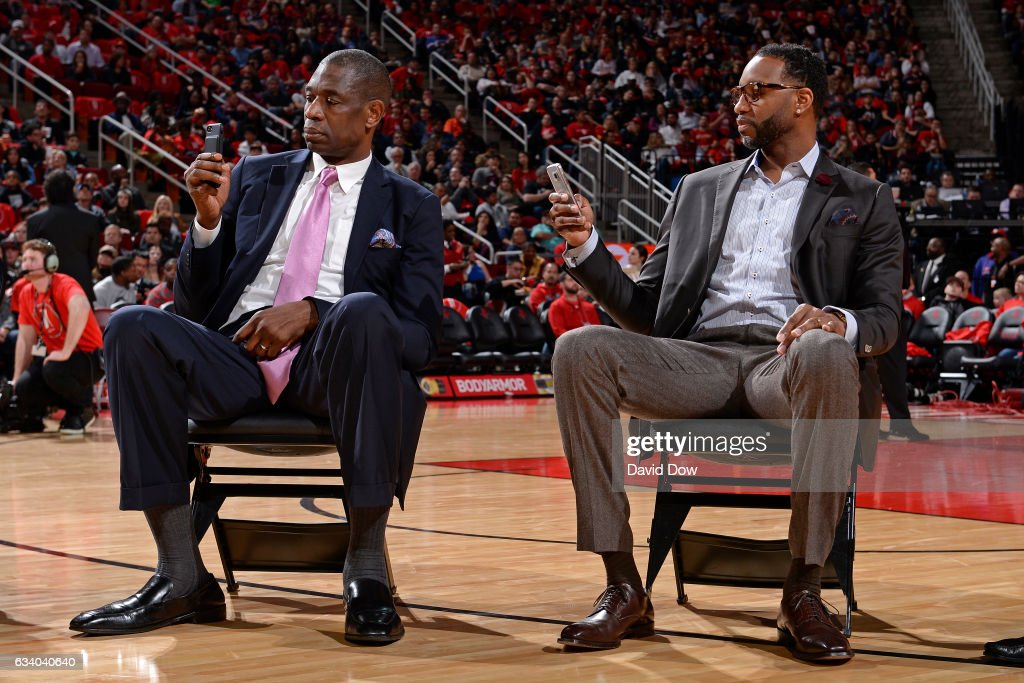 Legends, Dikembe Mutumbo and Tracy McGrady look on during the Yao Ming jersey retirement ceremony during the Chicago Bulls game against the Houston Rockets on February 3, 2017 at the Toyota Center in Houston, Texas.