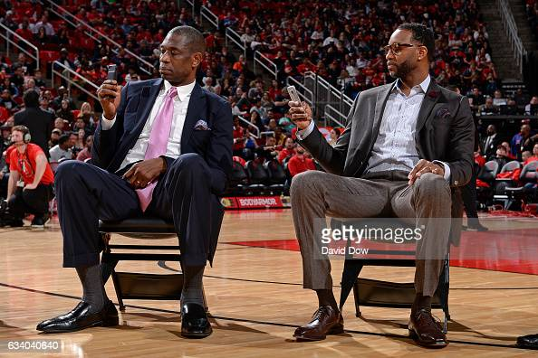 Legends Dikembe Mutumbo and Tracy McGrady look on during the Yao Ming jersey retirement ceremony during the Chicago Bulls game against the Houston...