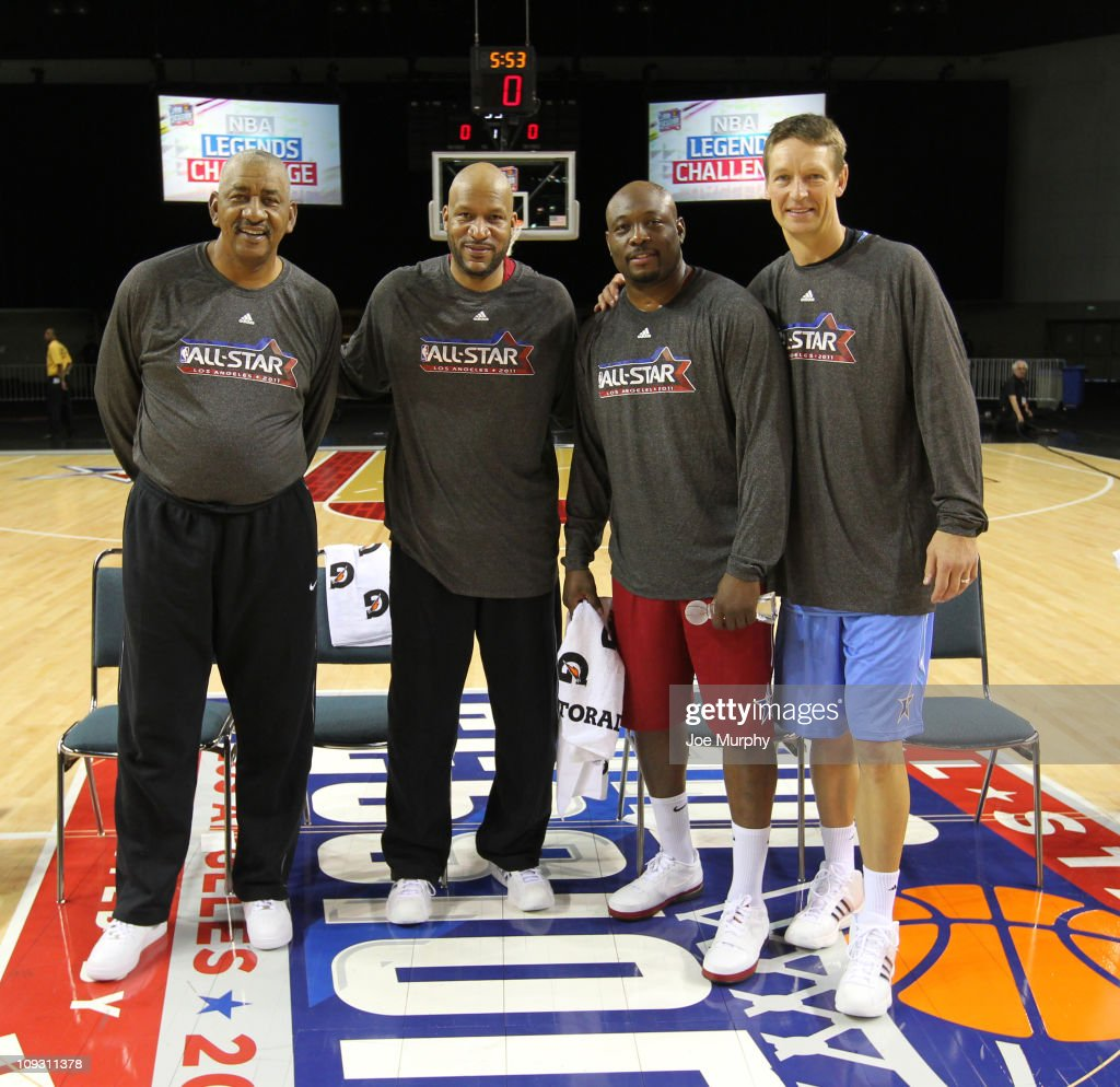 Legends George Gervin, Ron Harper, Mitch Ritchmond and Detlef Schrempf pose for a photo after the Legends Shootout on center court at Jam Session presented by Adidas during NBA All Star Weekend at the Los Angeles Convention Center on February 20, 2011 in Los Angeles, California.