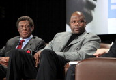 Legends Patrick Ewing and Elgin Baylor speak during the Martin Luther King Jr Day Sports Legacy Award Symposium before a game between the Memphis...
