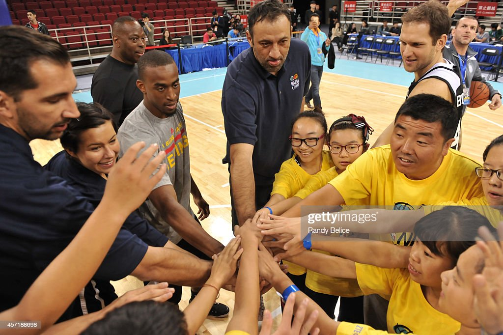 Legends Peja Stojakovic, Vlade Divac, Markel Brown and Bojan Bogdanovic of the Brooklyn Nets huddles in the NBA Cares Basketball Skills Clinic as part of the 2014 NBA Global Games at the MasterCard Canter on October 14, 2014 in Beijing, China.