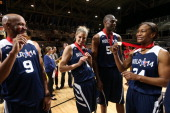 Legends Ron Harper and Dikembe Mutumbo Tamika Catchings of the Indiana Fever and Elena Delle Donne of the Chicago Sky of the East Team are awarded...