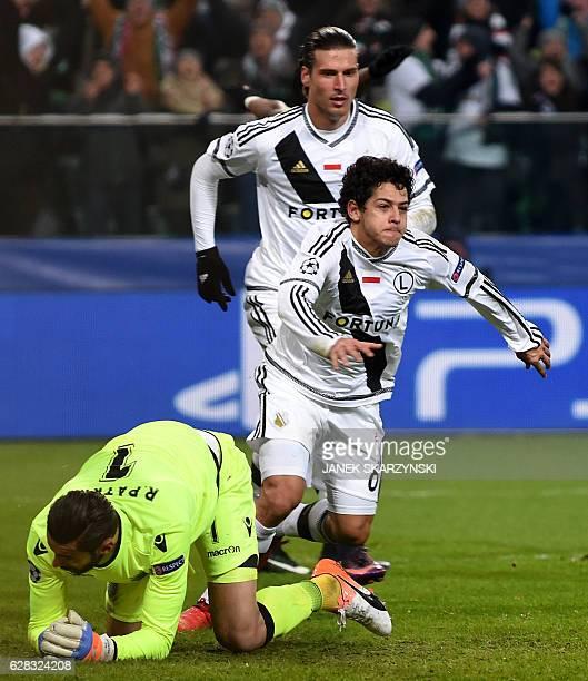Legia Warsaw's Brazilian midfielder Guilherme and Legia Warsaw's Swiss forward Aleksandar Prijovic react next to Sporting's goalkeeper Rui Patricio...