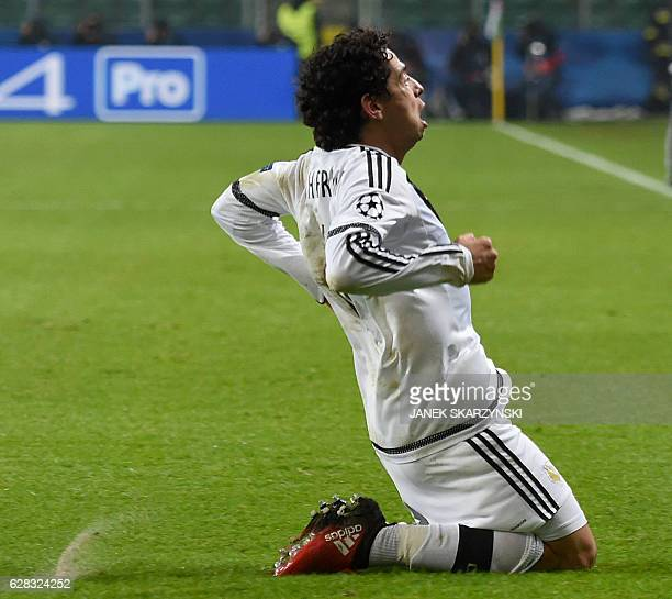 Legia Warsaw's Brazilian midfielder Guilherme celebrates scoring during the UEFA Champions League group F football match between Legia Warszawa and...