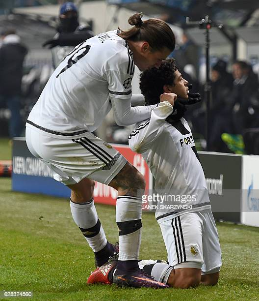 Legia Warsaw's Brazilian midfielder Guilherme celebrates with Legia Warsaw's Swiss forward Aleksandar Prijovic during the UEFA Champions League group...