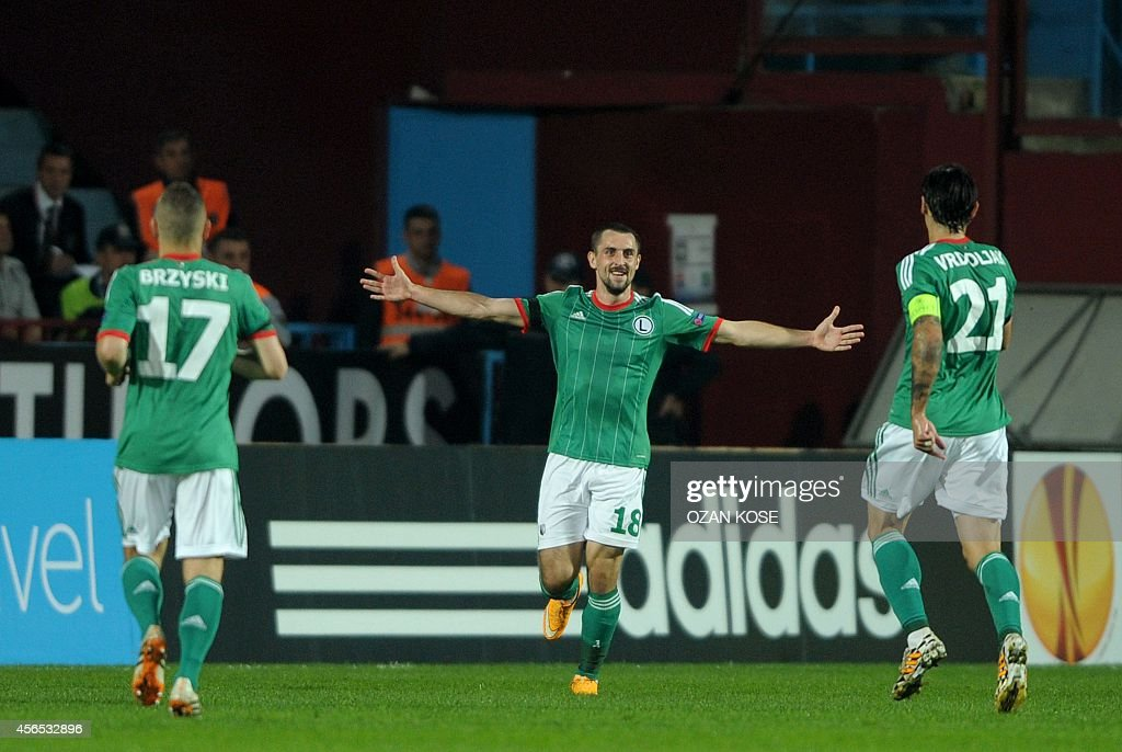 Legia Warsaw's Micha Kucharczyk celebrates with teammates after scoring a goal during the UEFA Europa League group L football match between...