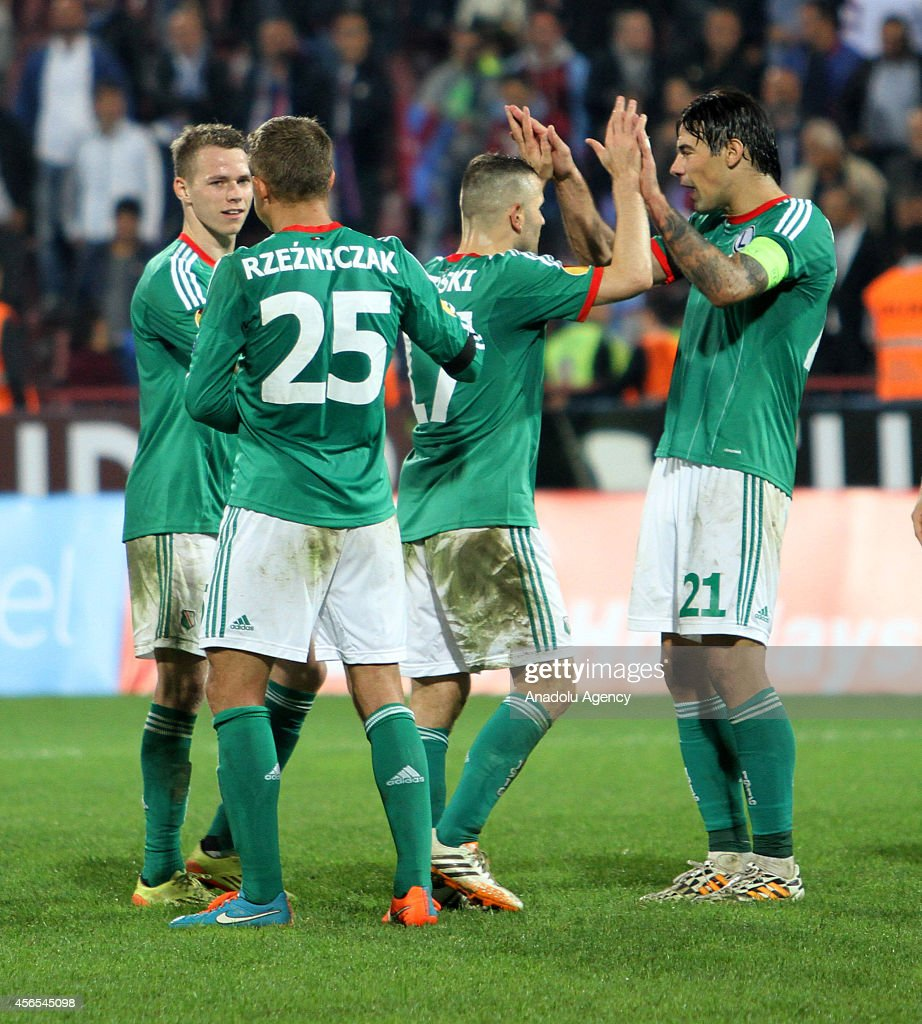 Legia Warsaw's players celebrate their victory at the end the UEFA Europa League Group L soccer match against Trabzonspor at Avni Aker Stadium in...