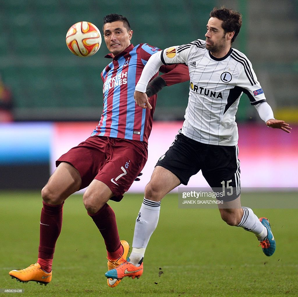 Legia's Inaki Astiz (R) and Trabzonspor's Oscar Cardozo vie for the ball during the UEFA Europa League Group L football match Legia Warszawa vs Trabzonspor AS in Warsaw, on December 11, 2014.