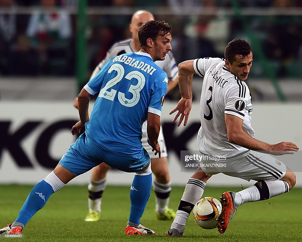 Legia's midfielder Tomasz Jodlowiec vies for the ball with Napoli's forward Manolo Gabbiadini during the UEFA Europa League firstleg Group D football...