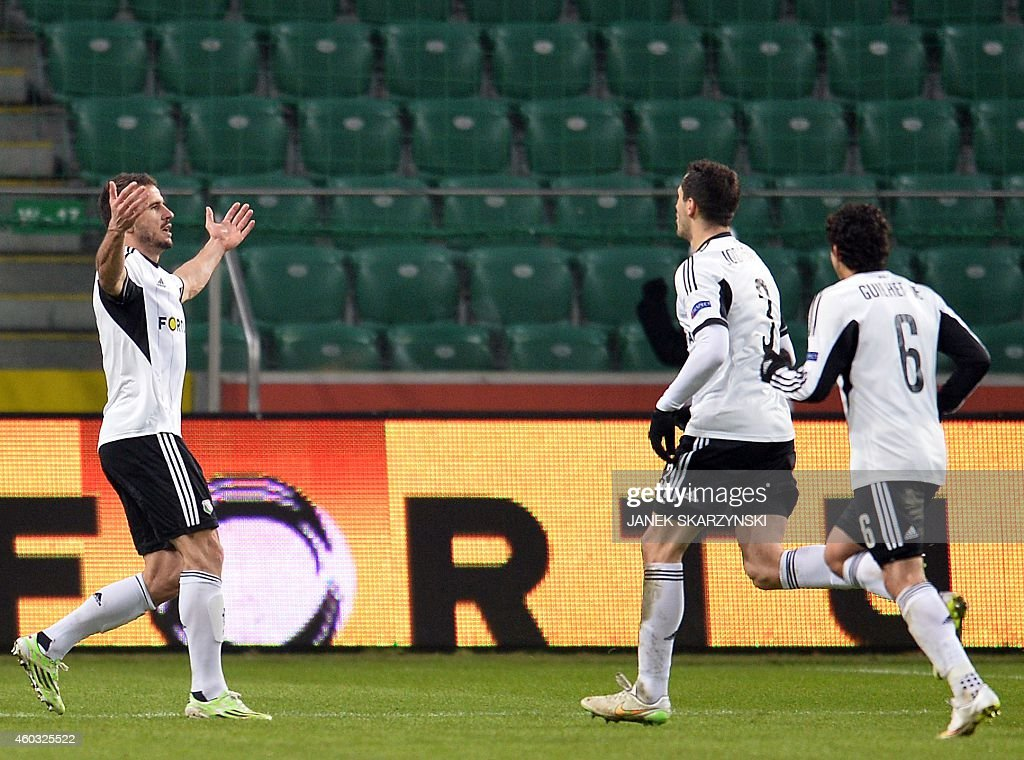 Legia's Orlndo Sa Tomasz Jodlowiec and Guilherme react after Sa scored second goal against Trabzonspo during the UEFA Europa League Group L football...