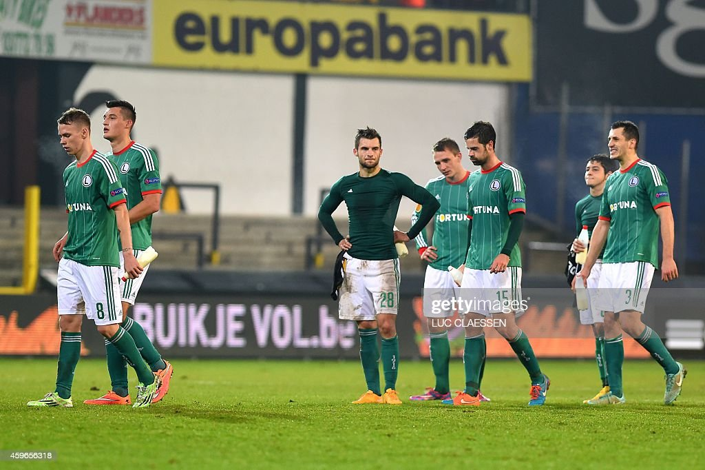 Legia's players react after the UEFA Europa League Group L football match between KSC Lokeren OVL and Legia Warszawa on November 27 at the Daknam...