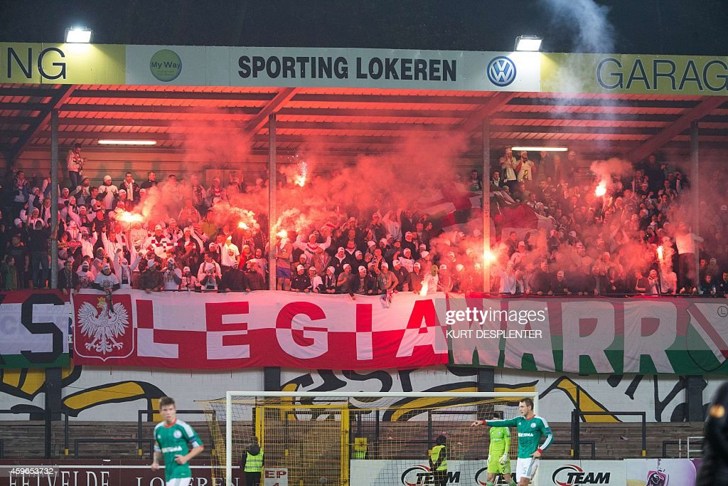 Legia's supporters cheer during the UEFA Europa League Group L football match between KSC Lokeren OVL and Legia Warszawa on November 27 at the Daknam...