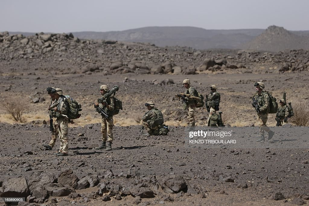 Legionnaires of the French army's 2nd Foreign Parachute Regiment are pictured during an operation in the Adrar of the Ifoghas mountains on March 17, 2013. A French corporal was killed tracking down jihadist fighters in their northern Mali mountain bastions, bringing to five the number of French deaths since Paris launched a military offensive in the country two months ago. Defence Minister Jean-Yves Le Drian said on March 17, 2013 the 24-year-old soldier was killed and three of his comrades wounded when their vehicle was struck by a roadside bomb blast in the Ifoghas mountains, without saying when it happened. AFP PHOTO / KENZO TRIBOUILLARD AFP PHOTO / KENZO TRIBOUILLARD