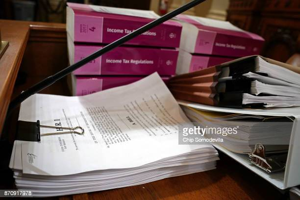 Legislation and regulation books are stacked and ready in the House Ways and Means Committee hearing room ahead of a markup session of the proposed...