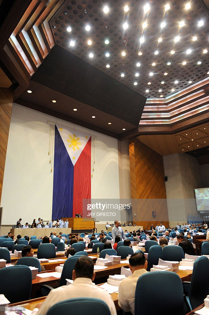 Legislators vote for the Reproductive Health Bill (RH) at the plenary hall of the House of Representatives in Quezon City suburban Manila on December 17, 2012. Philippine legislators on Monday passed a landmark birth control bill paving the way for increased sex education and free contraceptives, despite intense lobbying by the Catholic church.