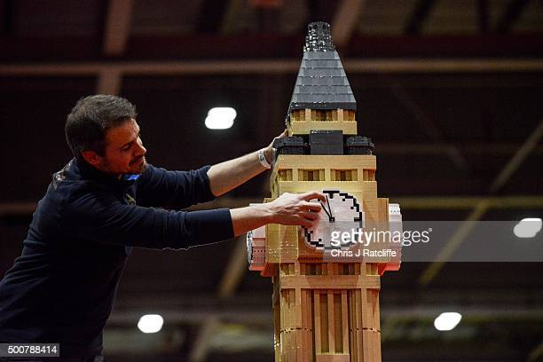 Lego builder adjusts the clock on Big Ben made out of 30000 bricks over 80 hours at ExCel on December 10 2015 in London England Brick 2015 is an...