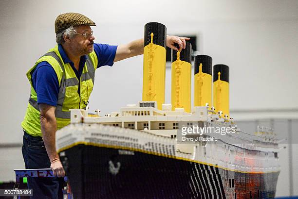 Lego builder Phil Traviss puts the finishing touches to his Titanic made out of 120000 bricks over 3 months at ExCel on December 10 2015 in London...