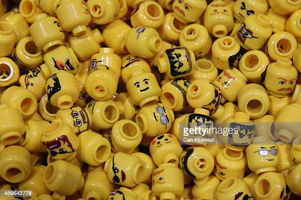 Lego figure heads are displayed on the opening day of BRICK 2014 at the Excel Centre on November 27 2014 in London England The four day event...