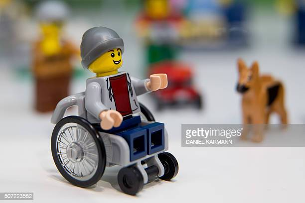 A Lego figure in a wheelchair is pictured at the Lego booth on January 28 2016 in Nuernberg during the 67th International Toy Fair / AFP / dpa /...