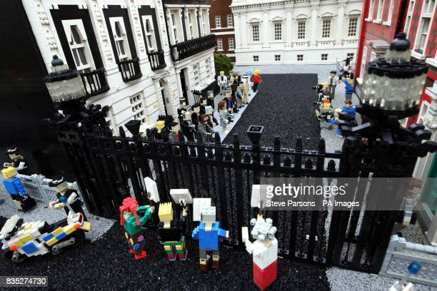Lego miniatures of the World leaders attending the G20 summit pose for the press outside a Lego Downing Street at Legoland Windsor as protestors wave...