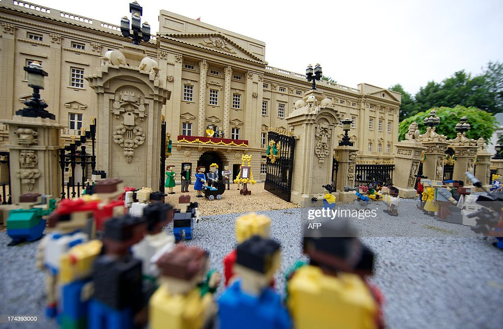 Lego models of Prince William, the Duke of Cambridge and his wife Catherine, The Duchess of Cambridge along with a pram containing a model of their newborn baby boy George Alexander Louis is postitioned outside a 36000 Lego-brick model of Buckingham Palace at Legoland in Windsor on July 25, 2013. Britain's press gave their seal of approval to Prince William and his wife Kate's decision to name their newborn baby boy George Alexander Louis, saying it had 'kingly authority'.