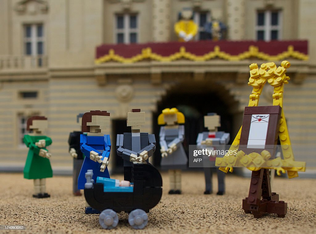 Lego models of Prince William, the Duke of Cambridge and his wife Catherine, The Duchess of Cambridge along with a pram containing a model of their newborn baby boy George Alexander Louis are postitioned outside a 36000 Lego-brick model of Buckingham Palace at Legoland in Windsor on July 25, 2013. Britain's press gave their seal of approval to Prince William and his wife Kate's decision to name their newborn baby boy George Alexander Louis, saying it had 'kingly authority'.