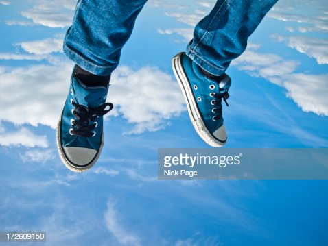 Legs and feet flying against a blue sky