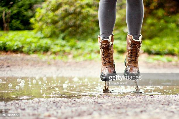 Legs and feet, jumping in puddle