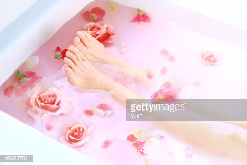 Legs and roses in hot bath. : ストックフォト