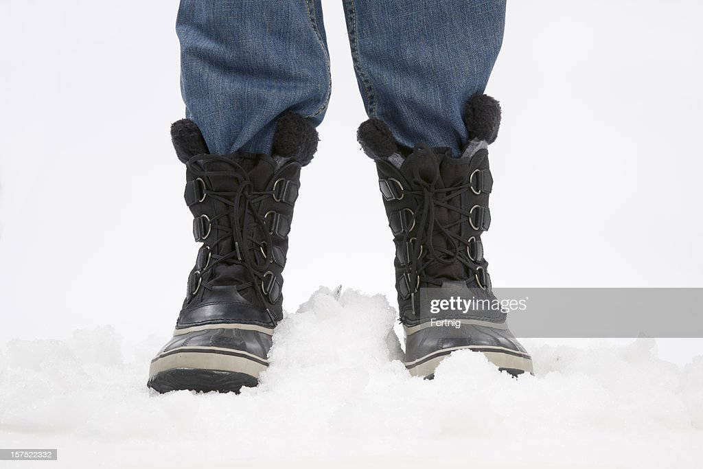 Legs and snow boots on ice