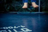 Legs floating in the air after jumping on the trampoline.