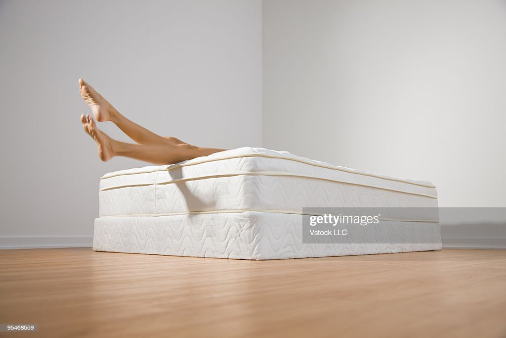 Legs hanging off bed