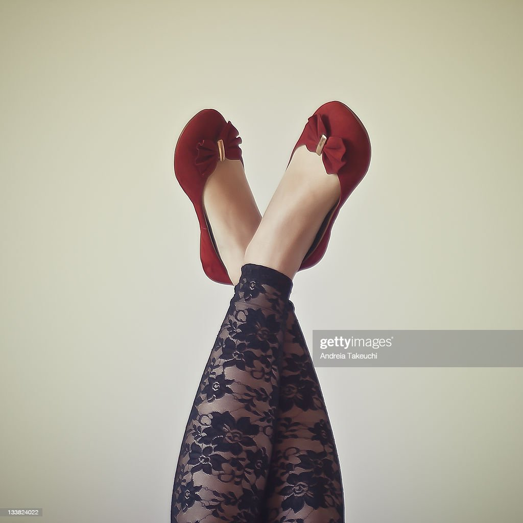 Legs in air with red flats and lace tights