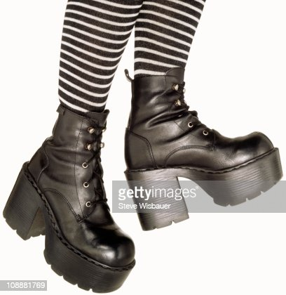 Legs In Stripped Tights And Platform Combat Boots Stock Photo ...