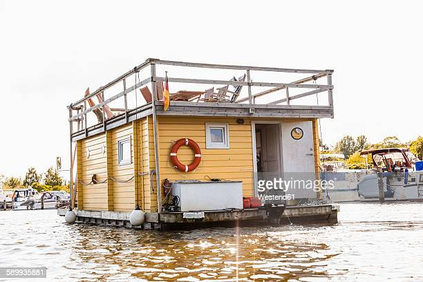 Legs of a couple on roof terrace on a house boat