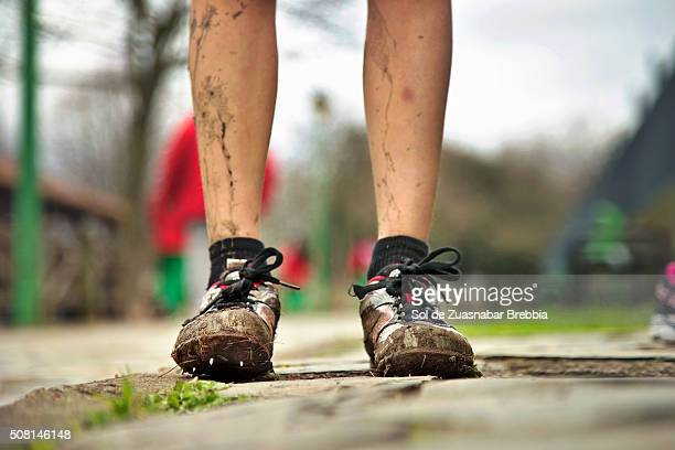 Legs of a girl with mud